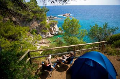 Intimate forest site with amazing views of the Med and it's down just the road from some of the Costa Brava's best beaches.