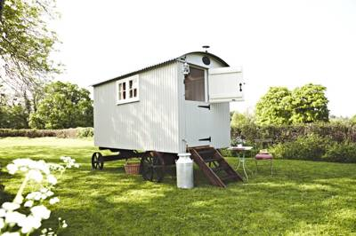 Nestled in the beautiful quiet of the South Downs national park, just an hour from London, you'll find the charming shepherds hut at The Shepherds Return.