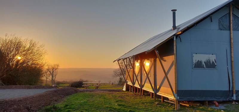 Sit back on the veranda of this Brecon Beacons safari tent and drink in the view.