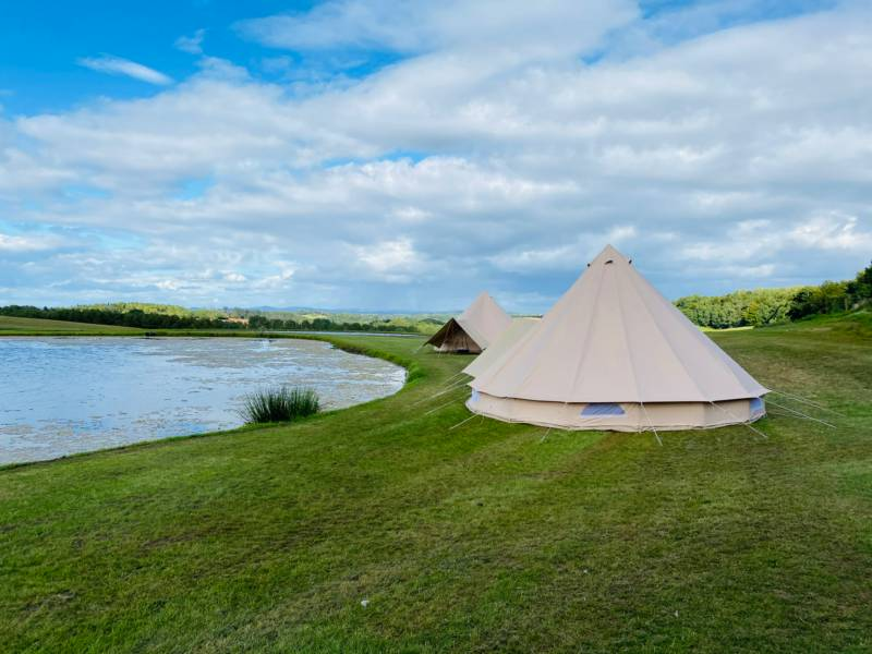 Just two bell tents beside a private lake. Book both the tents and you'll get the whole place to yourself!