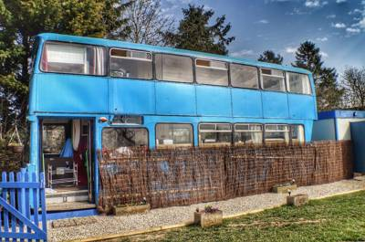Jump aboard Pigeon Door's converted 1981 Leyland Atlantean double-decker, parked just outside medieval Shrewsbury.