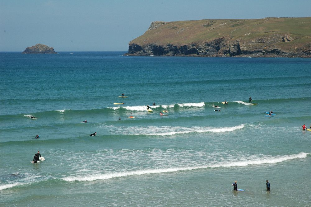 Surfing at Polzeath Beach