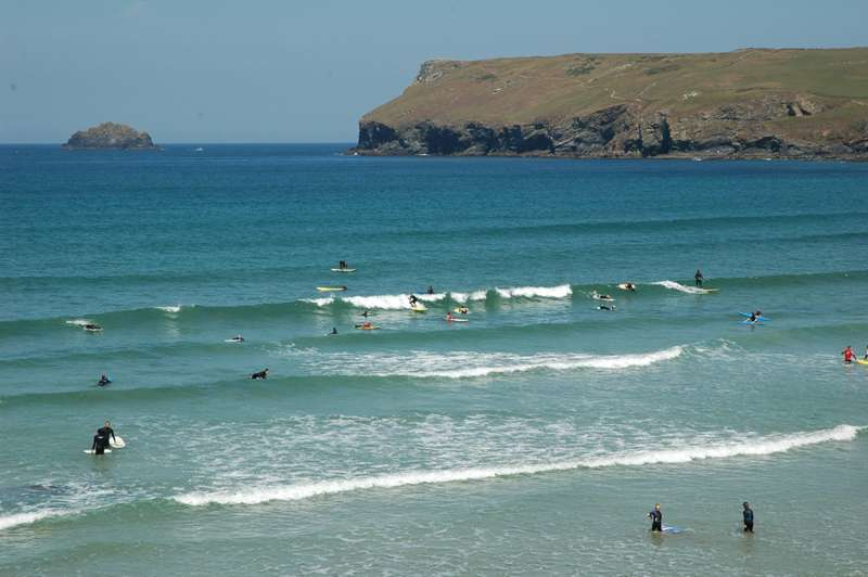 Surfing at Polzeath Beach