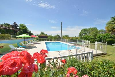 Rural camping in the Midi-Pyrénées, surrounded by sunflower fields and an easy drive from historic French towns.