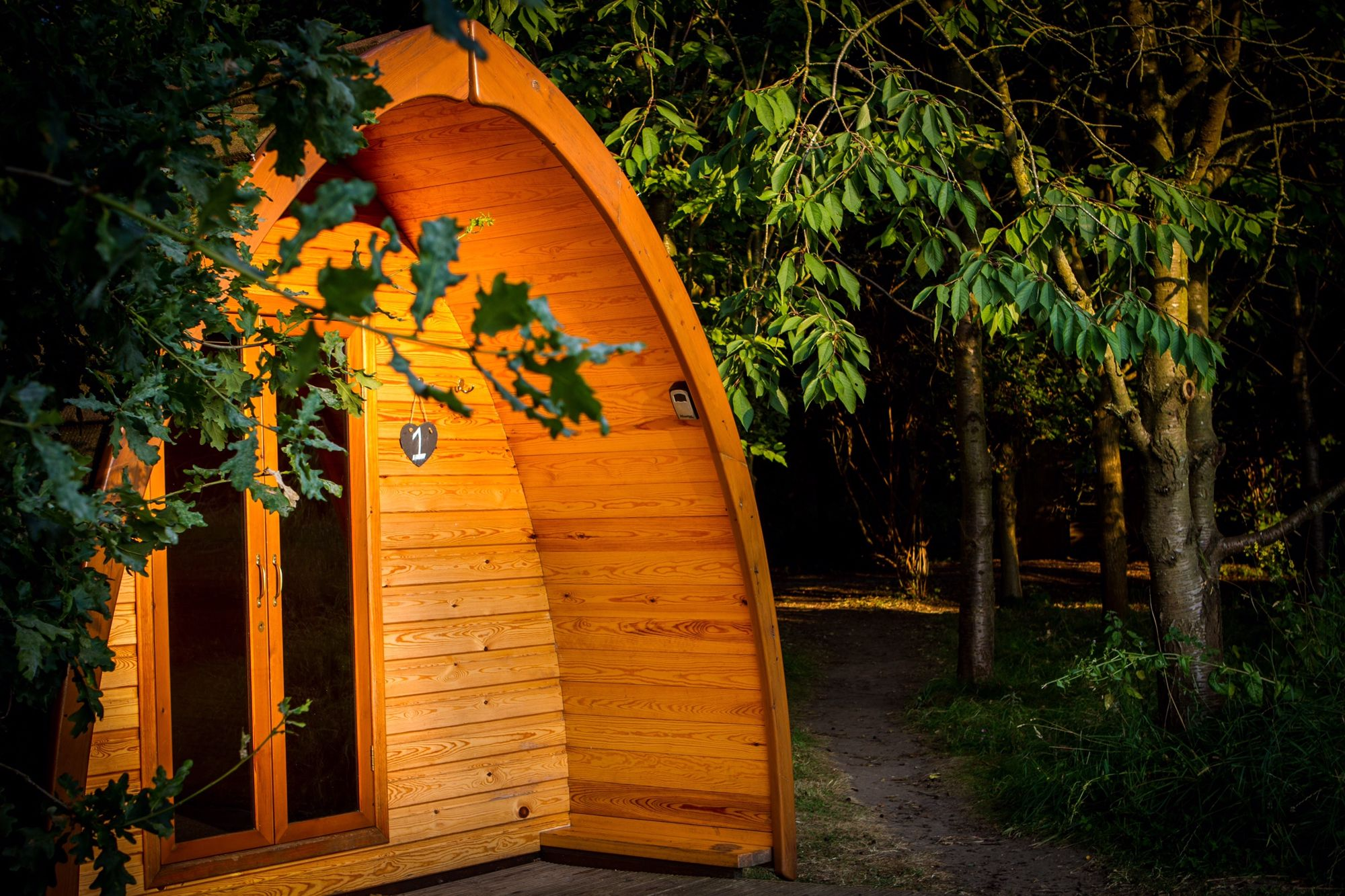 Off-the-grid camping in rural Lincolnshire set in secluded woodland with individual campfires.