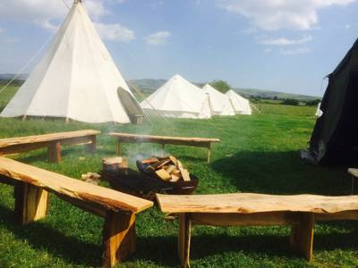 Back-to-nature glamping, camping and riverside campfires in rural West Sussex.