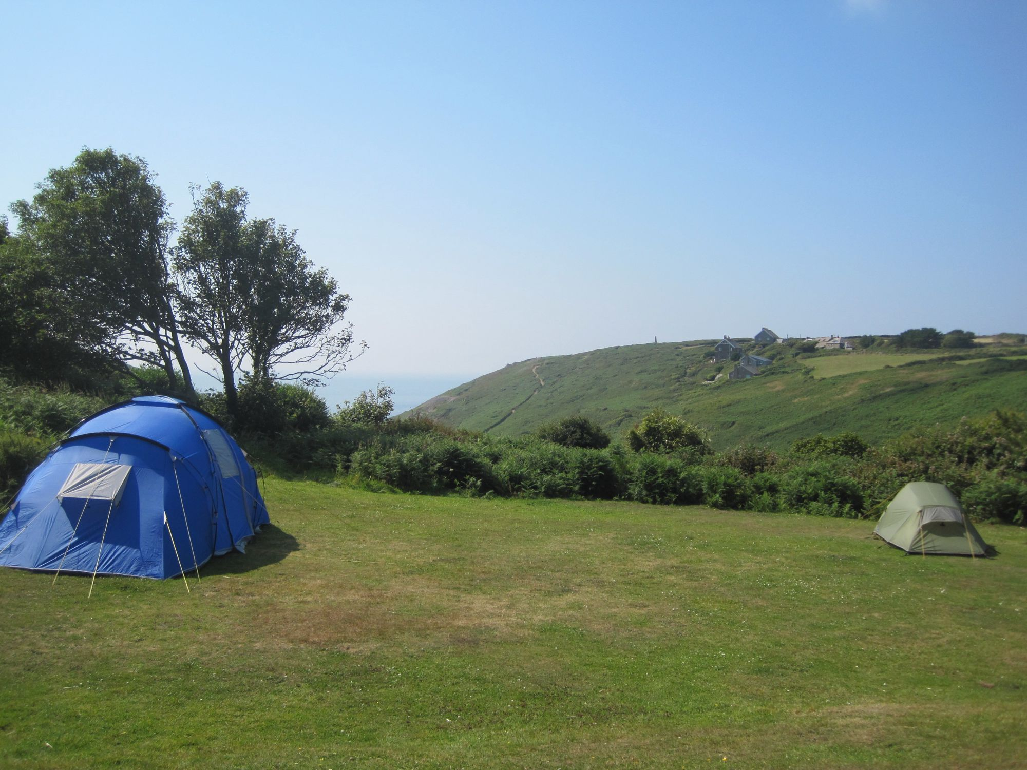 A well managed campsite in the garden of a YHA youth hostel out on the western tip of Cornwall.
