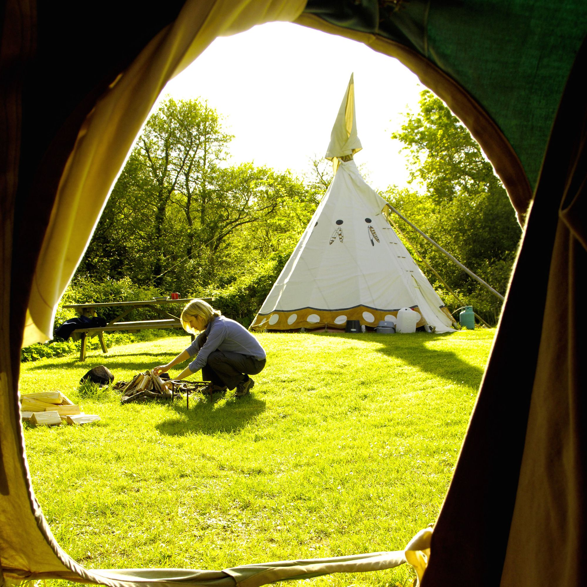 This is state-of-the art camping darling! Tipi huts nestled next to a beautiful aquamarine lake. Fabulously decadent!