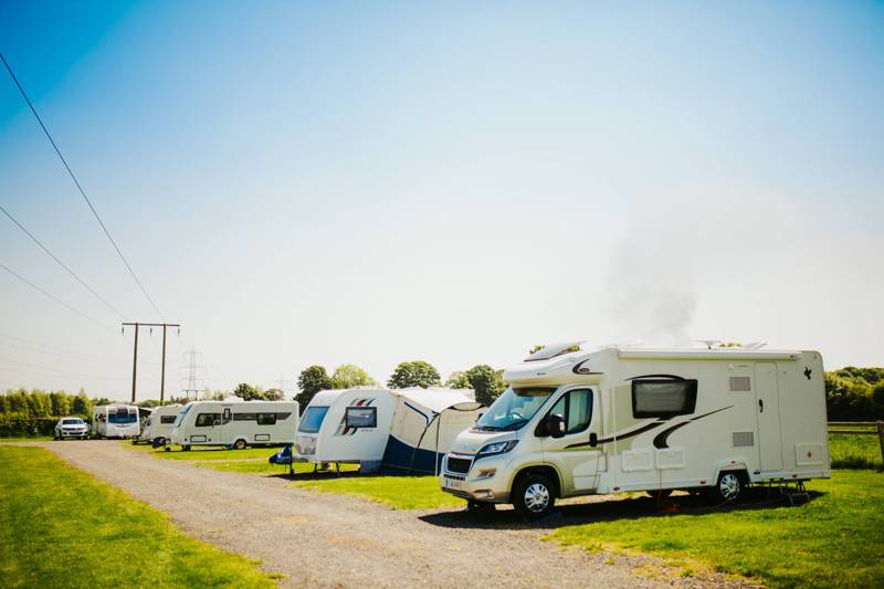 Caravans park up on the hardstanding pitches at Butt Farm Campsite, Beverley.