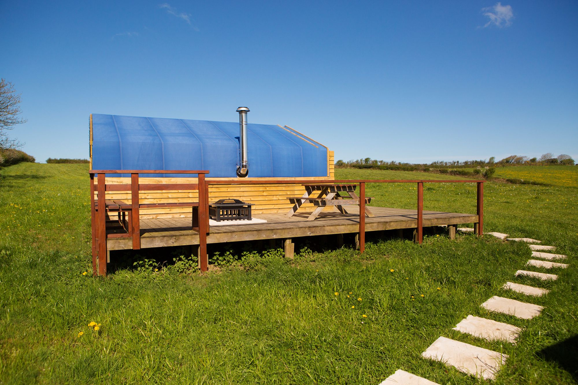 Wooden glamping cabins with a cosy interior that sleeps up to five people, set on an organic farm in Carmarthenshire, Wales.