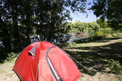 Idyllic site on the willowy banks of a quiet tributary of the Loire.