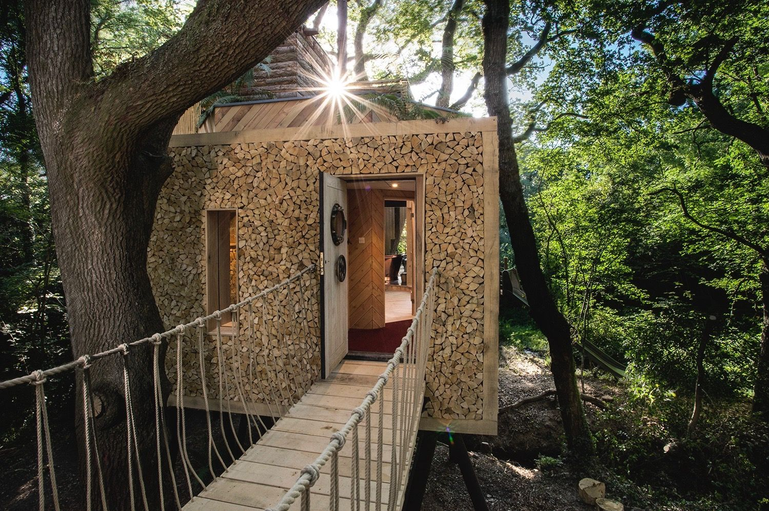 This secluded, sylvan sanctuary is a glamping Shangri-La. Deep in the heart of West Dorset, Crafty Camping features hand-crafted yurts, a wood-fired pizza oven and sauna!
