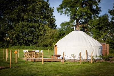 Luxury yurt glamping in the grounds of family-friendly Umberslade Farm Park.