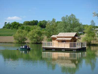 A pair of floating cabins on Lac de Pelisse accessed solely by rowing boat.