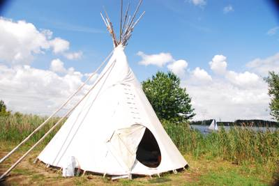 Luxury 'camping' on an island retreat, complete with real fires in the tipis.