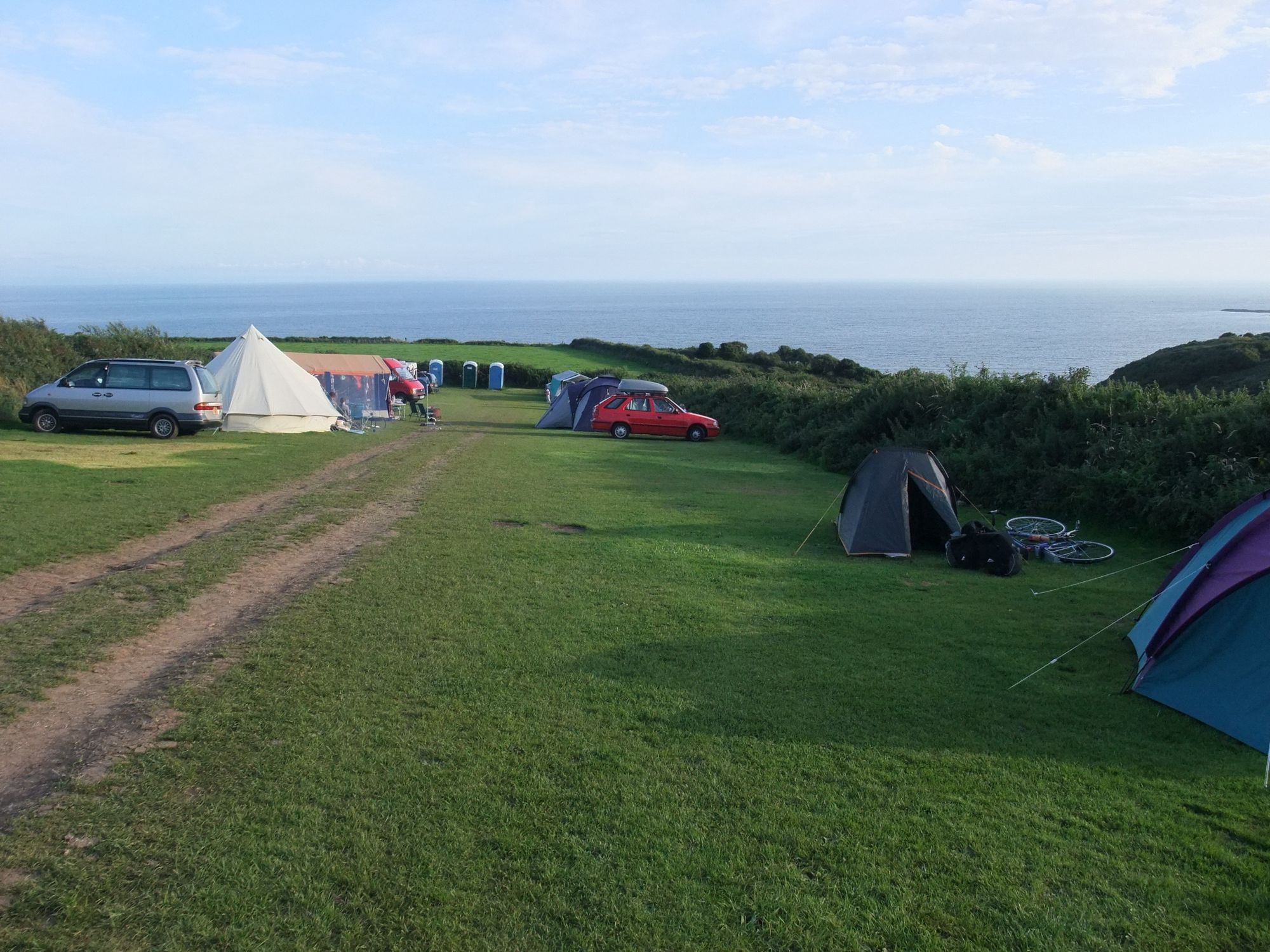 There's been a campsite in this field on the Gower Peninsula for 60 years, and there are no prizes for guessing why.