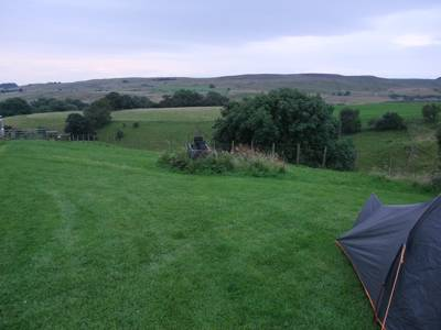 As evening wears on, all that can be heard from Highside Farm's campsite, on the lower reaches of Lune Moor, is the sporadic bleating of sheep far away across the valley.