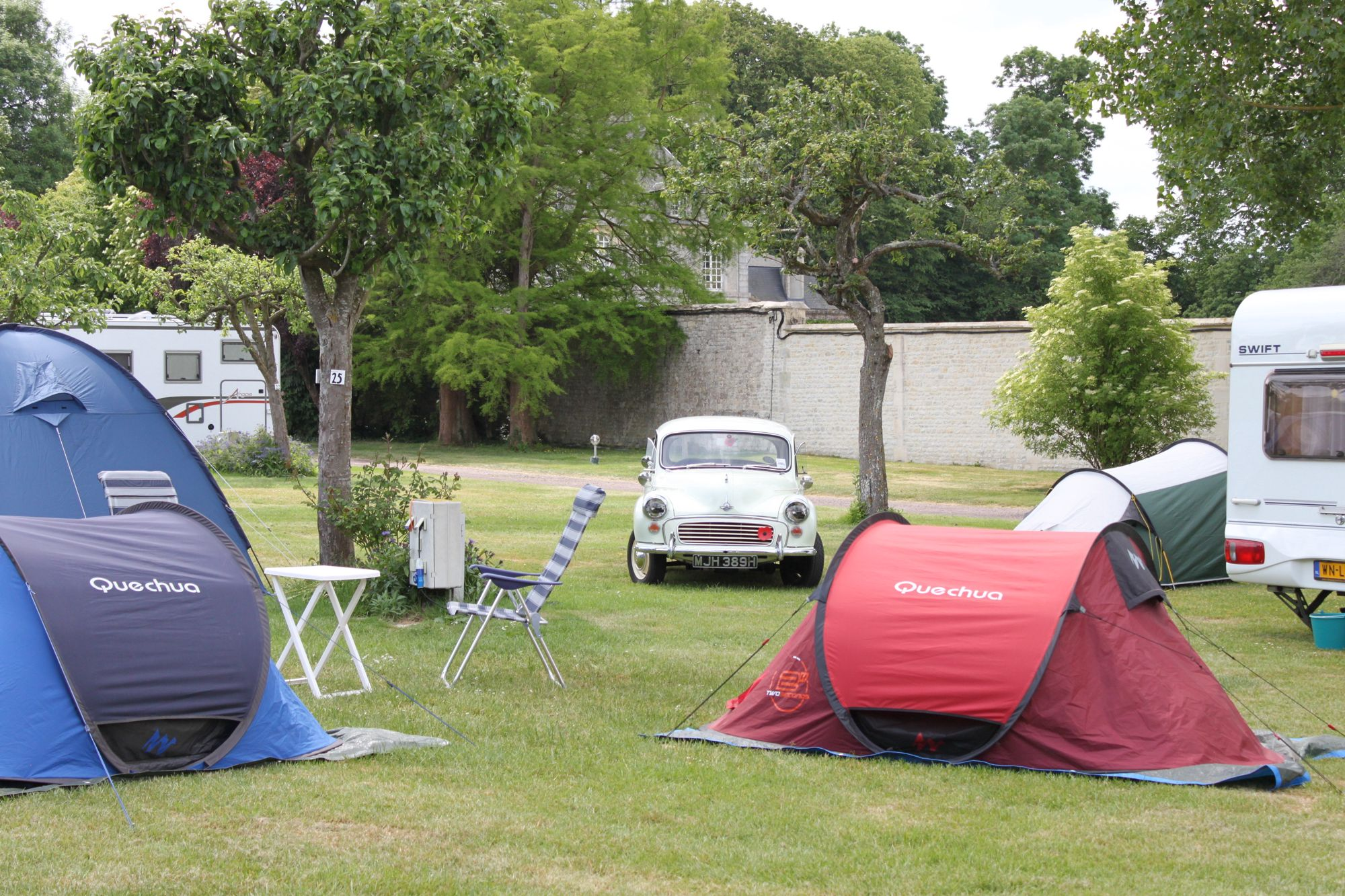 Camping in the grounds of a château a stones throw from historic Bayeux and the famous Normandy beaches.