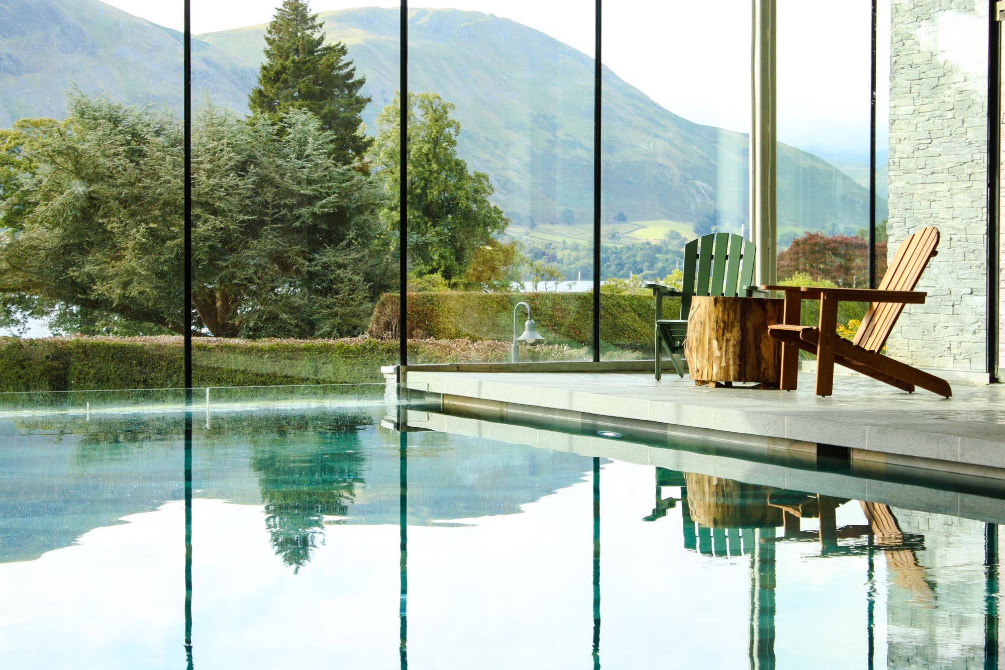 The swimming pool with lake views at Another Place, The Lake in Cumbria