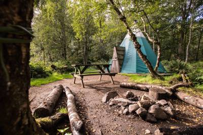 Modern camping in Scotland at its finest, perfect and peaceful for all the family. Best part? Tipi-style tents!