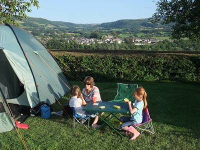 What nearly everybody does as soon as they've settled in at Radnors End (not so much a campsite as a well-coiffed back garden) is lie back and soak in the views.