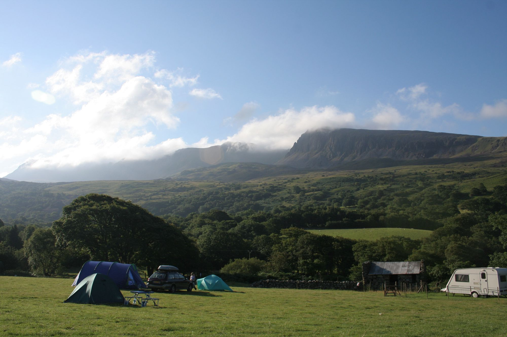 Camp at the foot and then ascend into the heavens via mirrored lakes, bare peaks and rocky cairns. It's summit special.