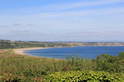 Majestic views over Oxwich Bay at this well-kept, well-organised Gower campsite.