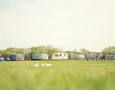 A family-friendly camping and caravanning site with exquisite views and one of the world's best beaches on the doorstep.