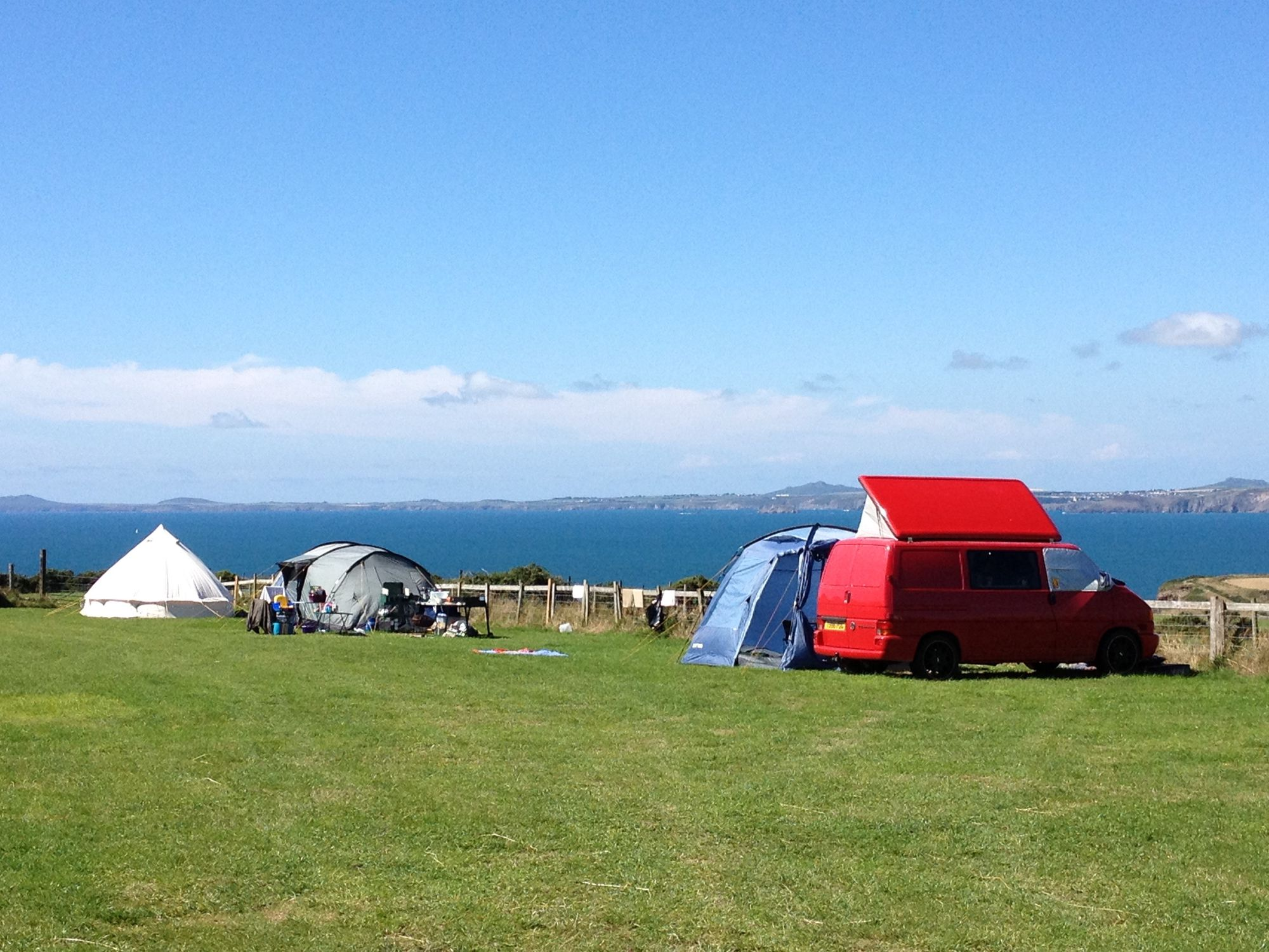 This traditional, 29 acre, cliff-top dairy farm at Druidston is a breathtaking, back-to-basics site that makes the ideal camp for those exploring the unspoilt Pembrokeshire coast.