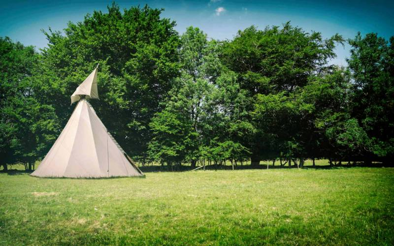A tipi at Wild Canvas Camping, a pop-up campsite with a festival vibe.