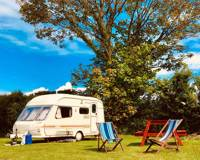 Caravan & camping pitch with fire pit