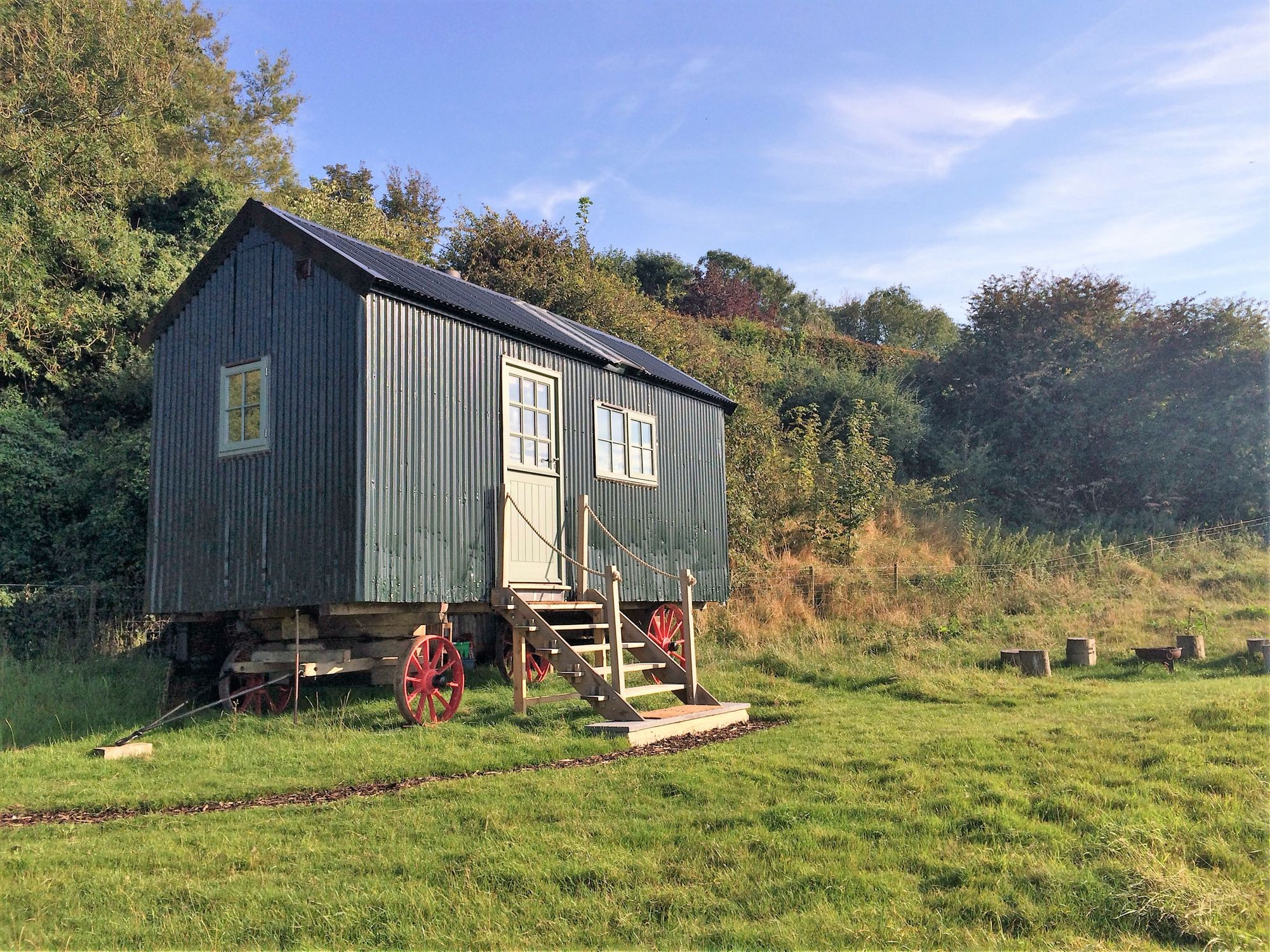 An authentic shepherd's hut in Kent, restored from the 1890s and kitted out for couples with a king-sized bed, wood-burning stove and views over the Kent Downs.