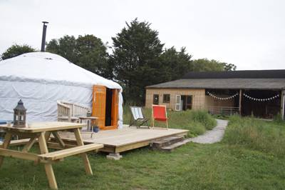 You need only flick through the guestbook in the bunting-strewn communal Dutch barn at Somerset Yurts for a taste of this site's restorative powers.