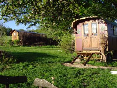 Characterful caravans in an idyllic and flowery setting.