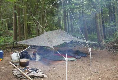 Too good for tents? What about sleeping in the middle a wood with only a tarpaulin for protection? Real-life bush camping fun!