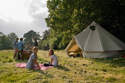 A charming Dorset campsite overlooking the beautiful Stour valley and a short walk from both the river and the market town of Wimborne Minster.