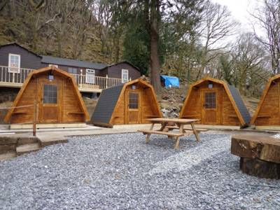 """A welcome in the hillside"" awaits at this excellently-equipped pod site in the heart of Snowdonia."
