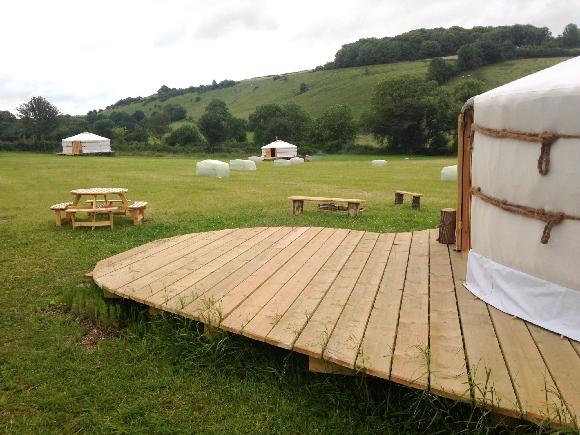Yurts and bell tents on an organic Dorset Downs farm... with it's own onsite farm shop... AND a stream for paddling! All that's missing is the massage and hampers... Oh wait a minute...