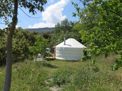 The privacy of a single yurt, poised in a hidden corner of the Sierra Nevada mountain range, halfway between the historic city of Granada and the Mediterranean coast.