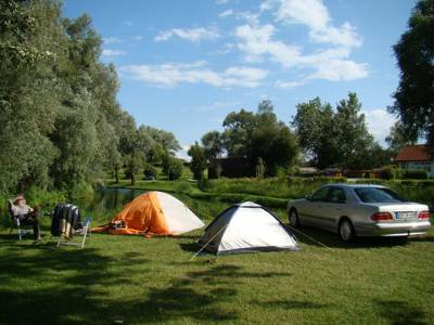 Camping on the banks of the mighty Danube with the charming Austrian town of Au an der Donau on the doorstep and forest clad mountains in the background.