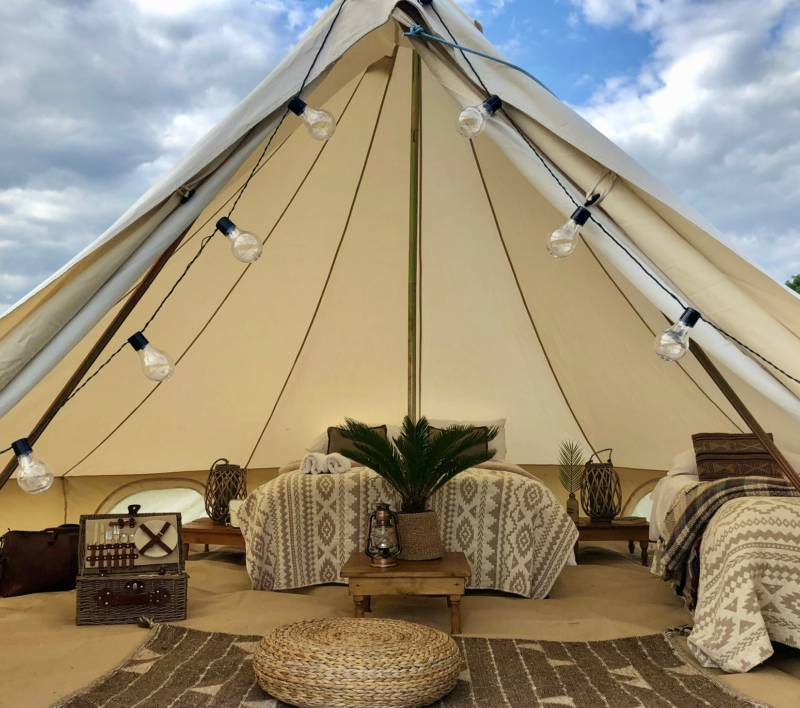 Bell tent with bedding