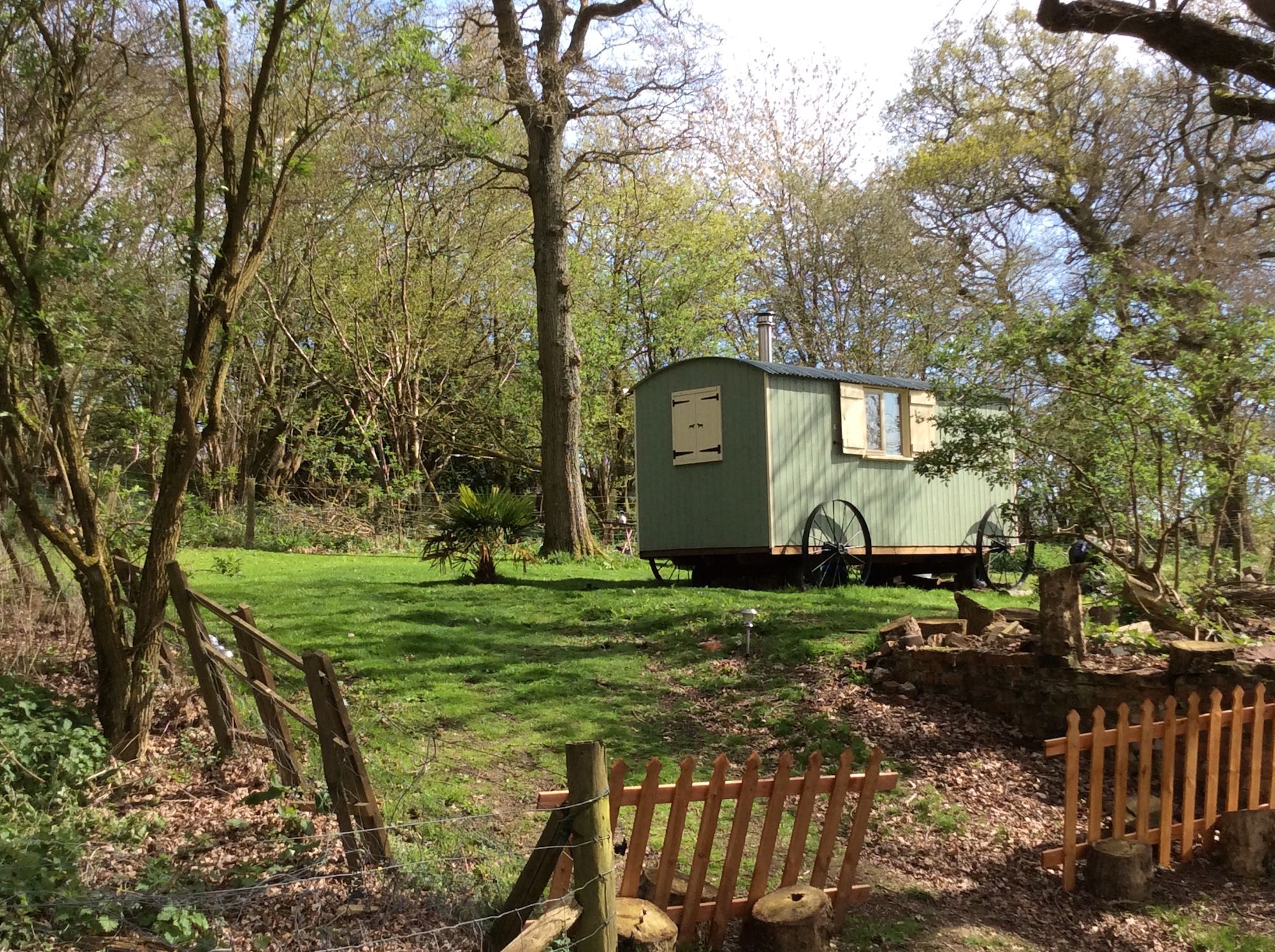 Glamping in West Sussex: A family-run site with cosy shepherd's huts, all with a superb location on the South Downs Way.