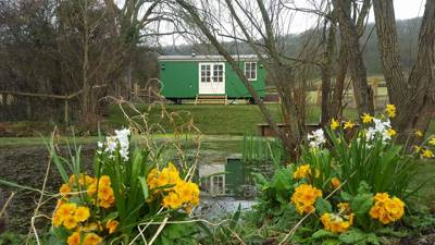 A private, pond-side shepherd's hut that offers high-end glamping comforts just three miles from the Somerset coast.