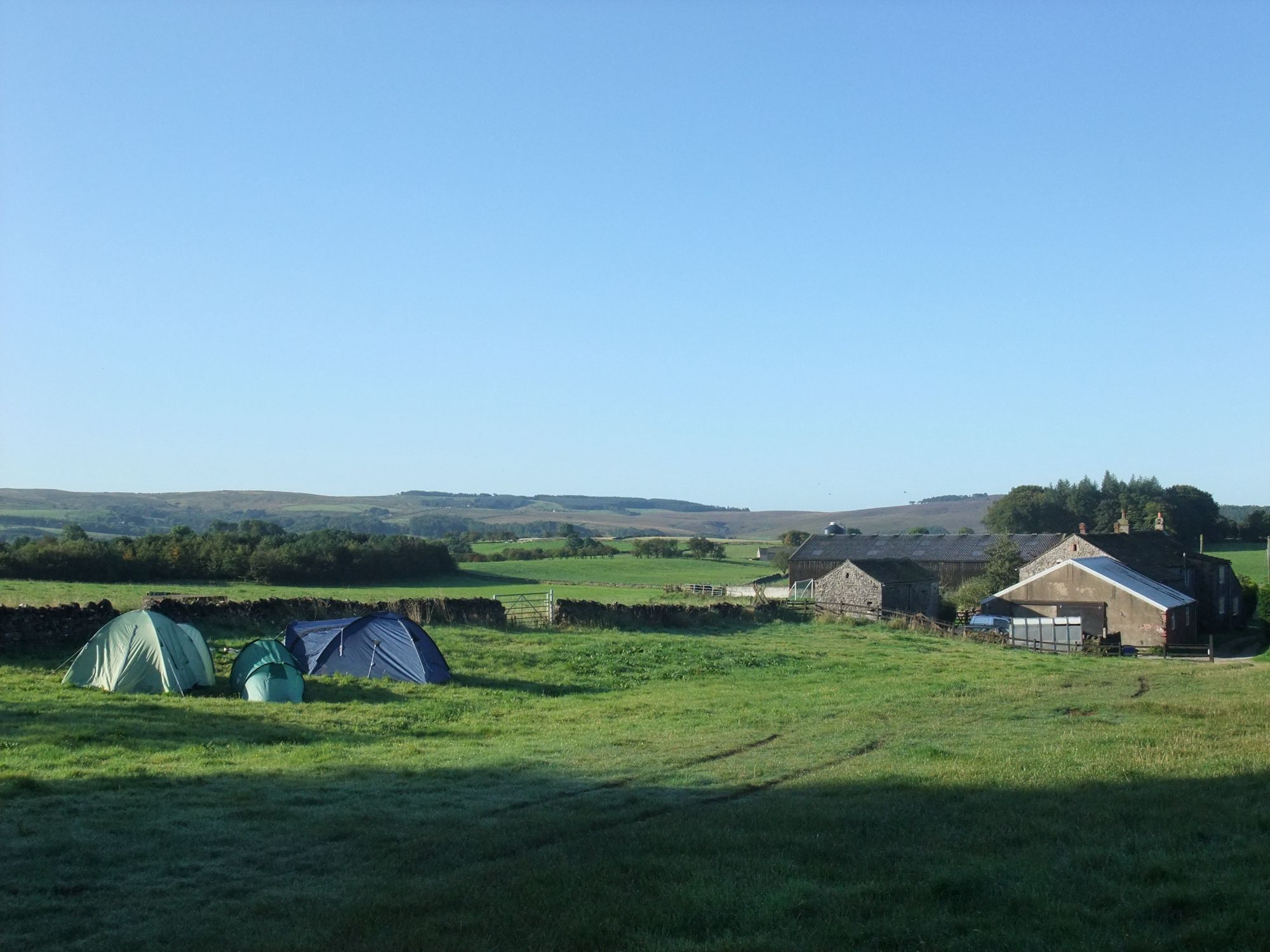 This is the sort of campsite Britons hold in their collective memory: a simple open field bounded by a drystone wall, with a loo in a lean-to by the farmhouse, and drinking water sourced from a tap coming out of a wall.