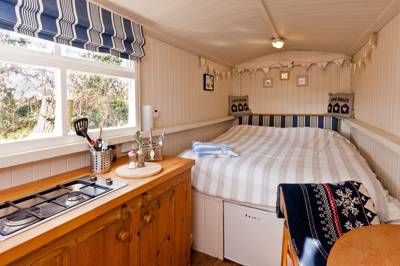 A cosy coastal Shepherds hut that sleeps two, with a top location, amicable hosts and everything required for a luxury escape.