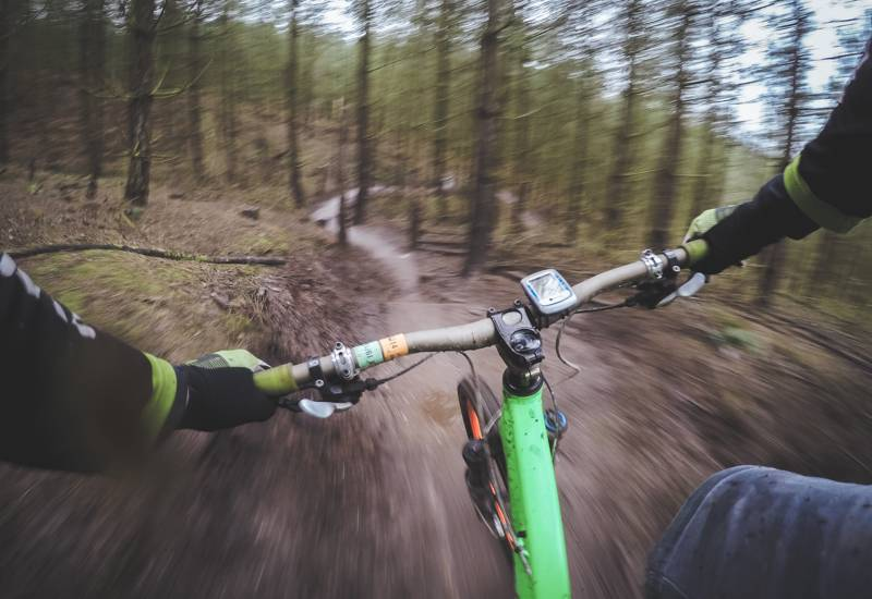 Flying down the mountain biking trails in the Scottish Highlands.