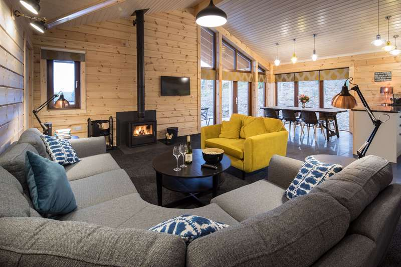 The luxury cabins at The Lodges at Artlegarth in Cumbria all come with with wood-burner and private hot tub