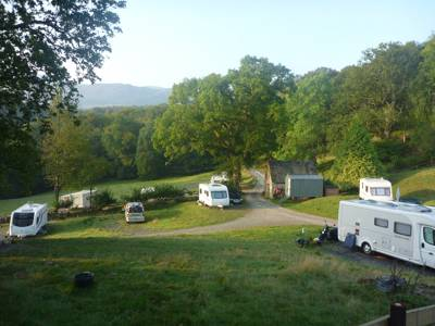 A small camping and caravanning site with stunning views over Dolgellau, North Wales, and a large, well stocked, fishing lake.