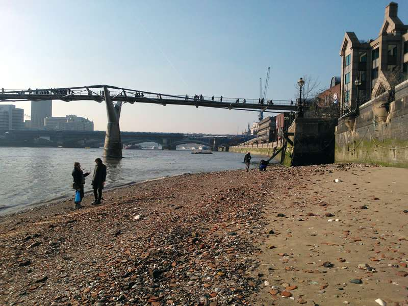 Mudlarking under the Millennium Bridge