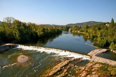 Family camping and caravanning, right on the Ardèche river with your own private beach.